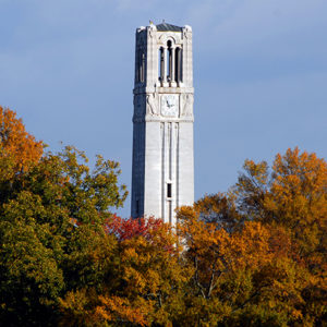 Memorial Belltower rises up from behind the changing leaves of Fall. PHOTO BY ROGER WINSTEAD